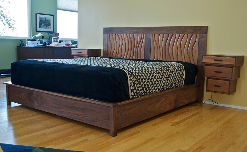 Kings size walnut and cherry bed  with sculpted headboard and floating night stands.