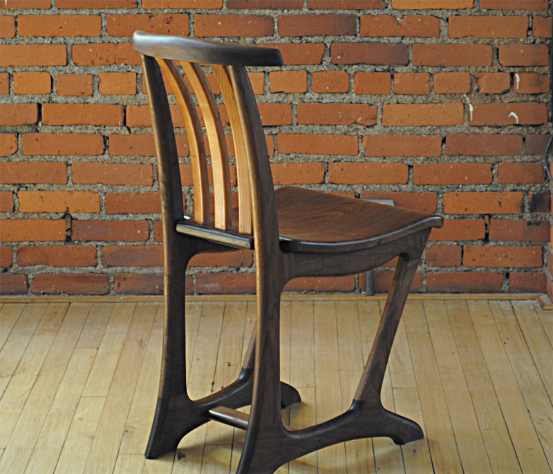 sculpted organic dining chair in walnut and cherry