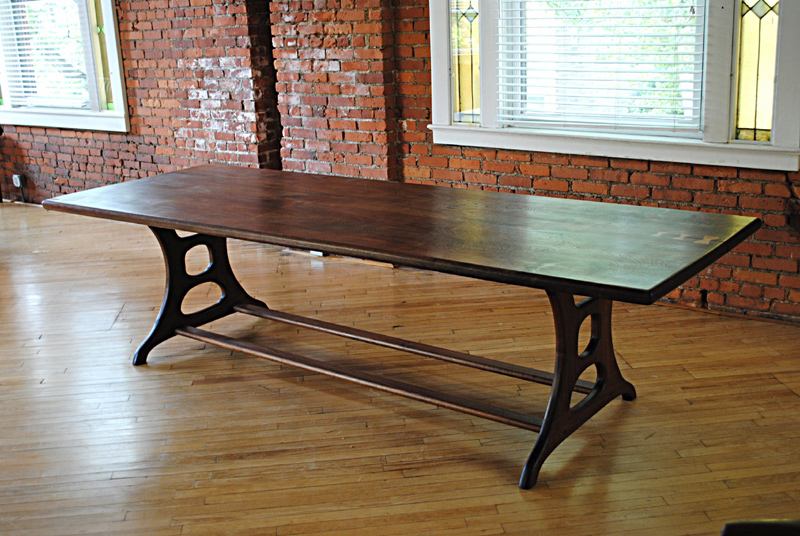 12 person sculpted walnut dining table.  This table top is 120